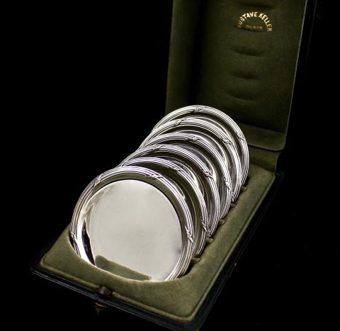 Набор серебряных персональных пепельниц от Gustave Keller